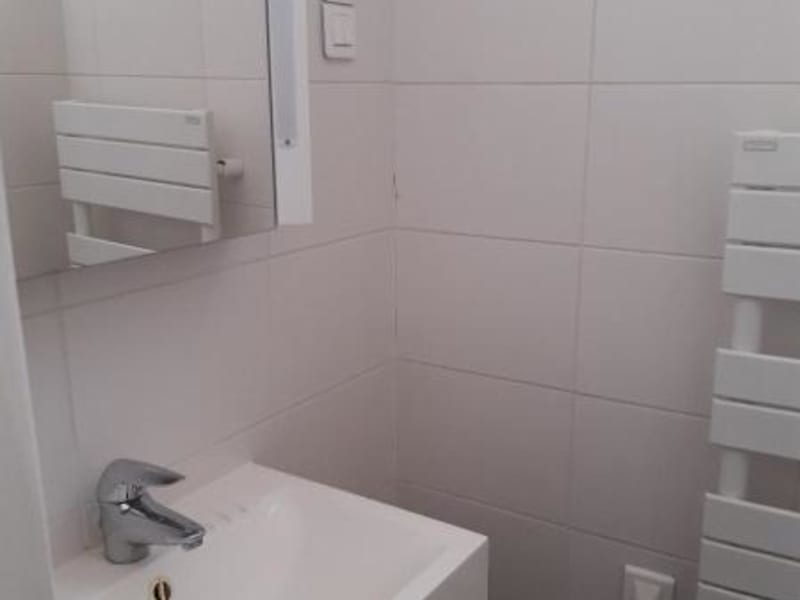 Location appartement Paris 16ème 3 208€ CC - Photo 9