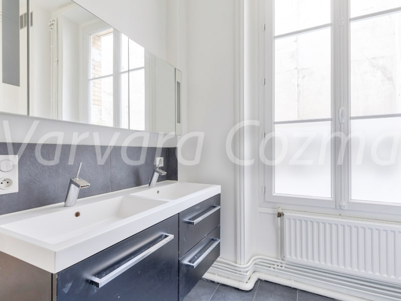 Location appartement Paris 3ème 4 250€ CC - Photo 8