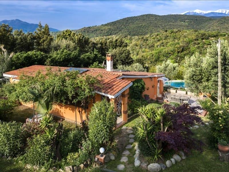 Sale house / villa Oms 400000€ - Picture 2