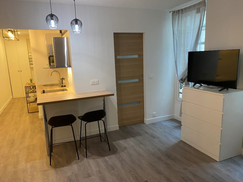 Location appartement Paris 2ème 1 190€ CC - Photo 4