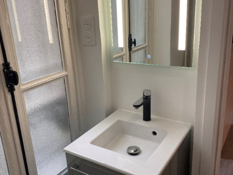 Location appartement Paris 2ème 1 190€ CC - Photo 7