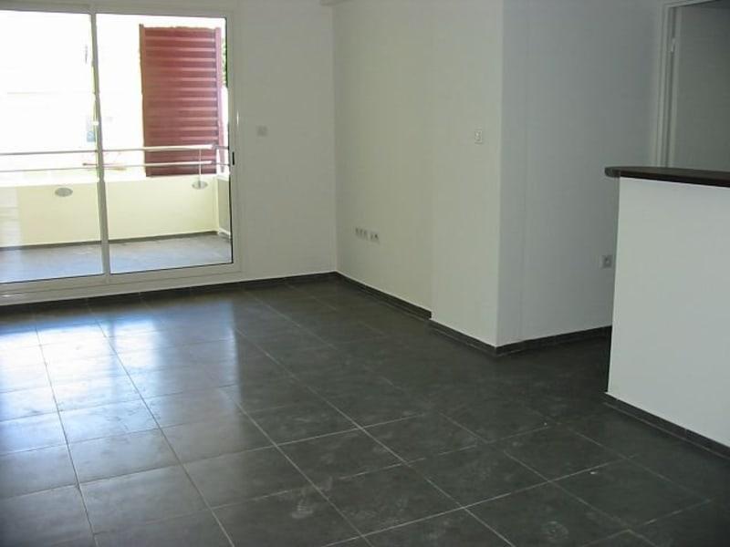 Location appartement Ste clotilde 715€ CC - Photo 1