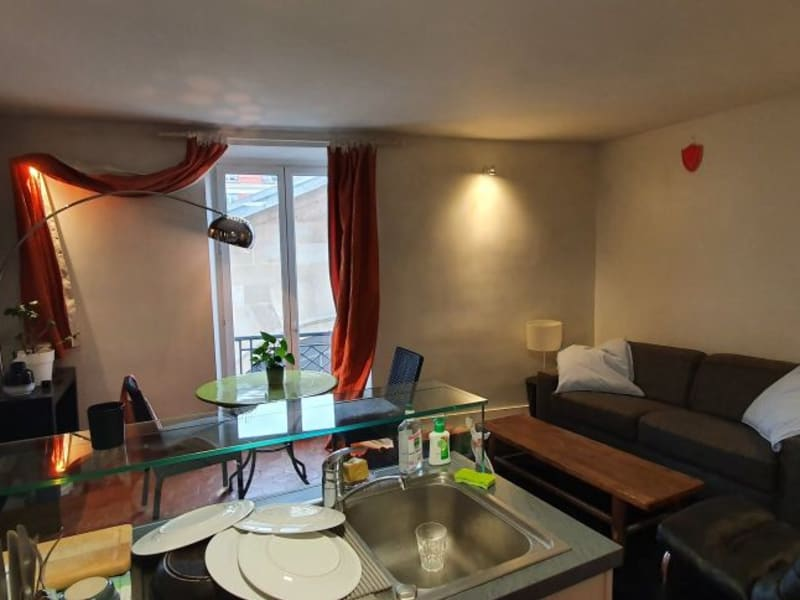 Location appartement Paris 4ème 1 074€ CC - Photo 3