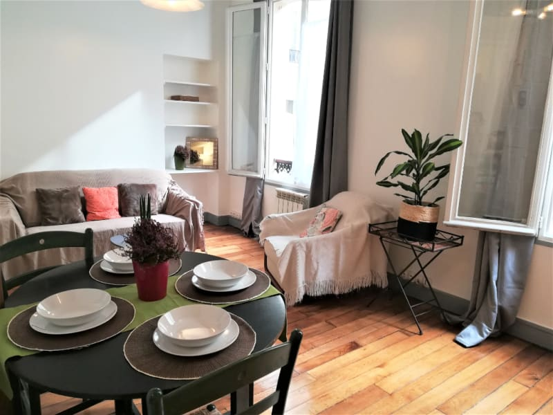 Rental apartment Paris 11ème 1 380€ CC - Picture 2