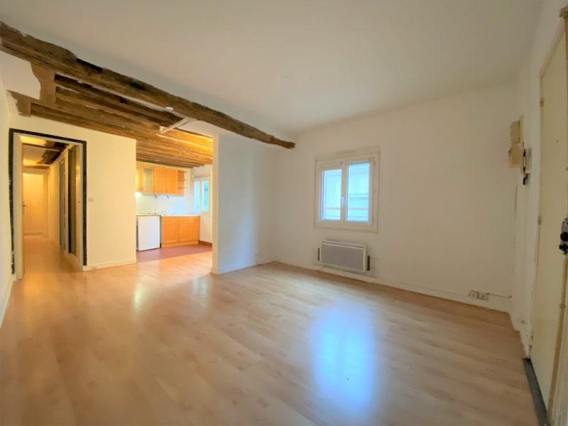 Rental apartment Paris 4ème 1346€ CC - Picture 1