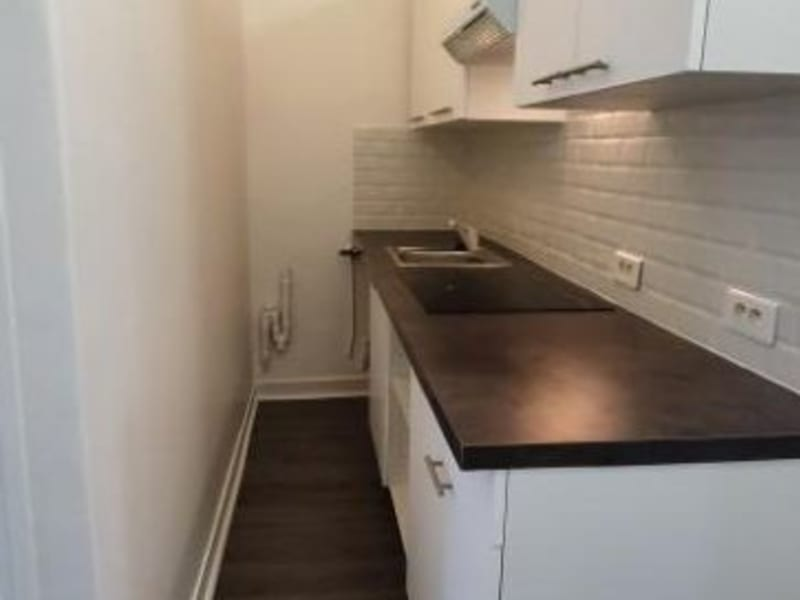 Location appartement Paris 10ème 1 520€ CC - Photo 5