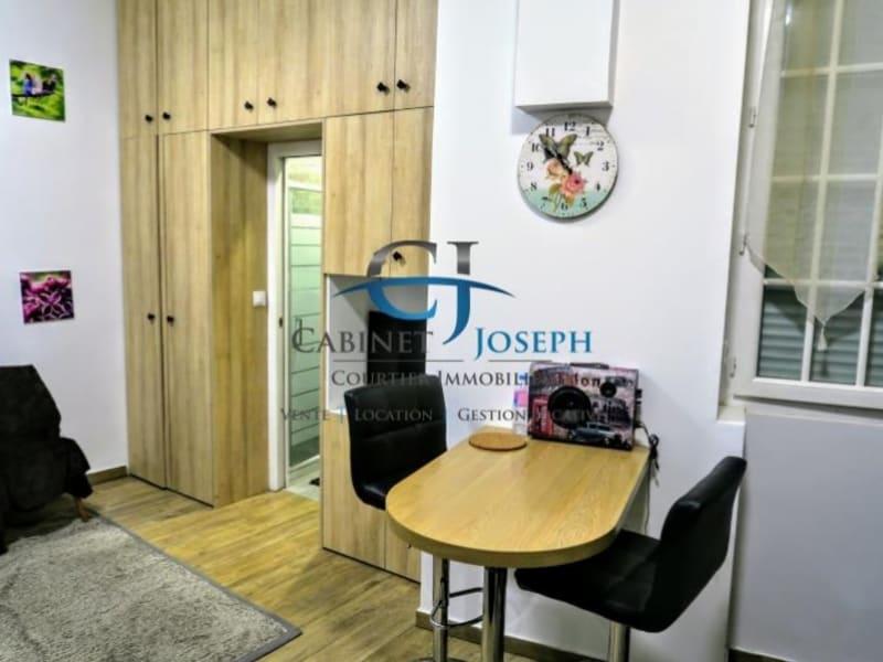 Rental apartment Paris 18ème 949€ CC - Picture 1