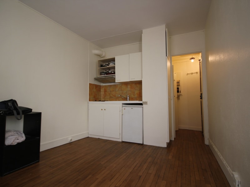 Location appartement Paris 4ème 897,91€ CC - Photo 4