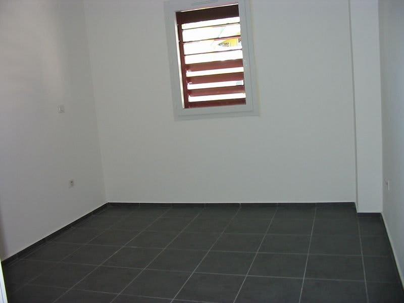 Location appartement Ste clotilde 610€ CC - Photo 4