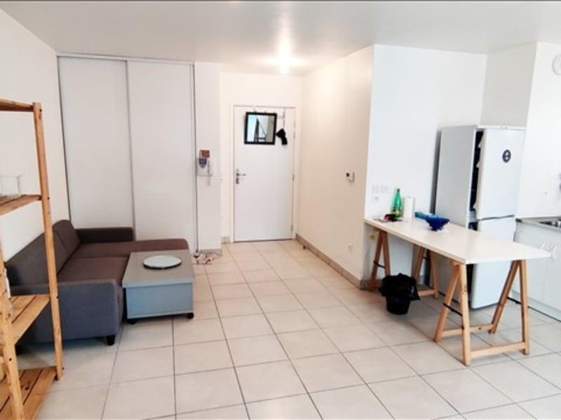 Rental apartment La plaine st denis 1050€ CC - Picture 2