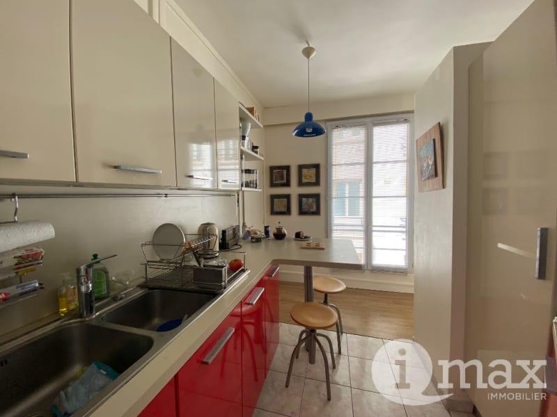Sale apartment Paris 1er 500000€ - Picture 4