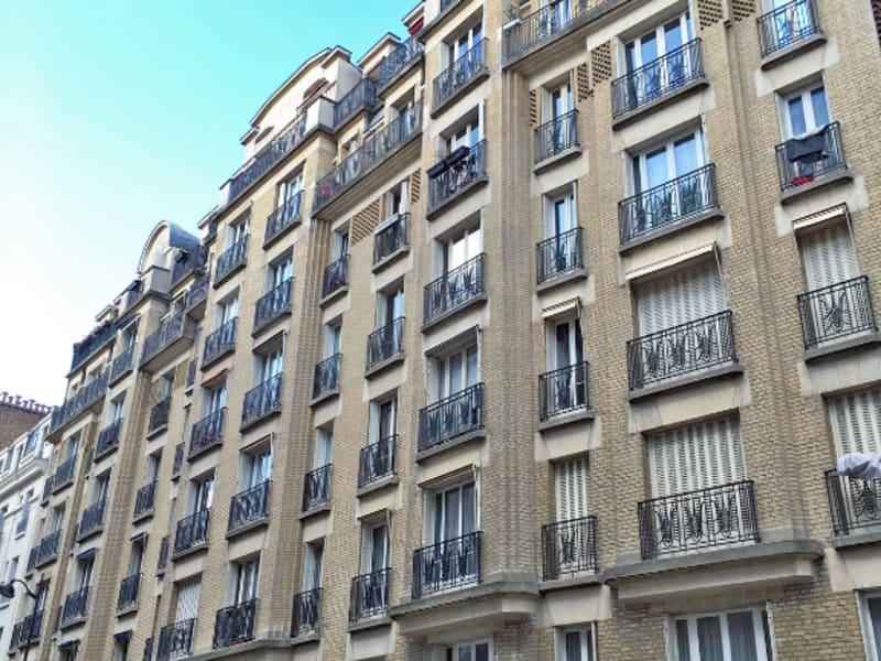 Rental apartment Paris 18ème 1465€ CC - Picture 1