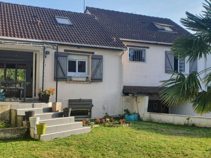 Sale house / villa Osny 480000€ - Picture 1