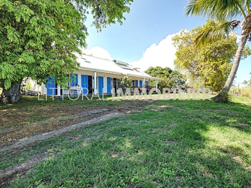 Sale house / villa La possession 666500€ - Picture 1