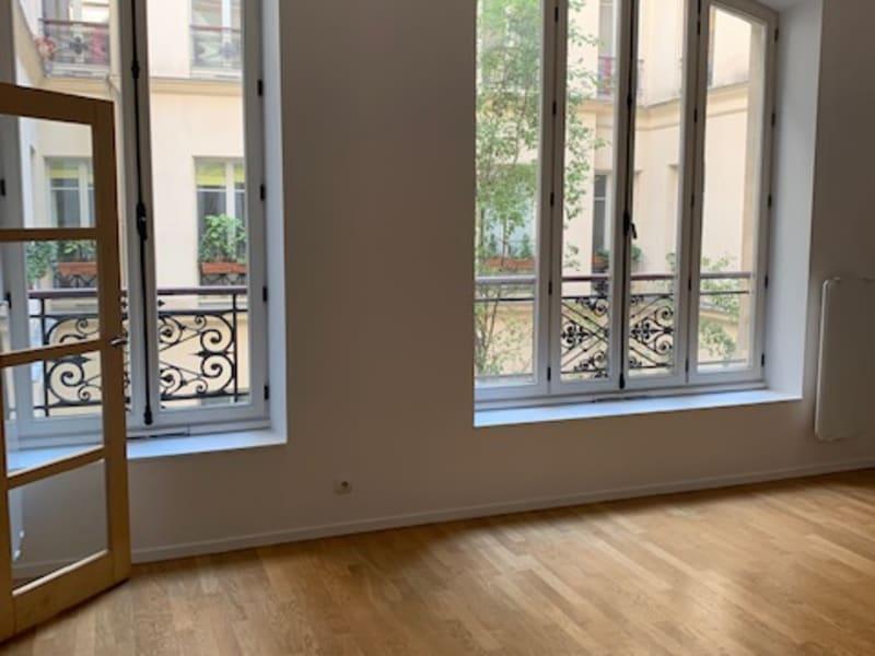 Rental apartment Paris 9ème 1810€ CC - Picture 1
