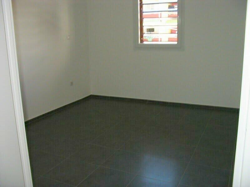 Location appartement Ste clotilde 593€ CC - Photo 3