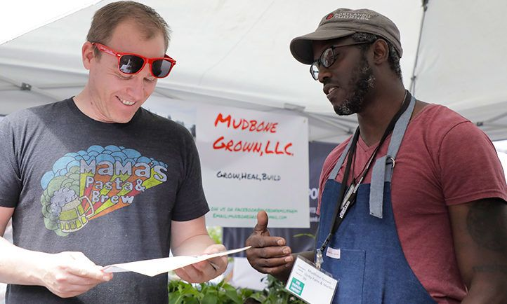 A Mudbone Grown farmer discusses community-based farming at My People's Market in summer 2018.