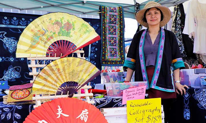 Colorful arrays of fans, reusable calligraphy sets and more at local vendor's My People's Market booth in summer 2018.