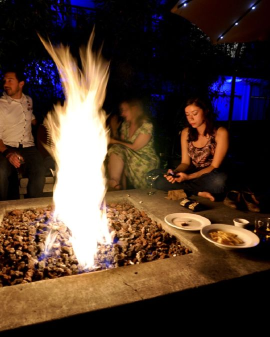 Catch an indie band concert, then warm up by the roaring fire pit at Doug Fir Lounge.