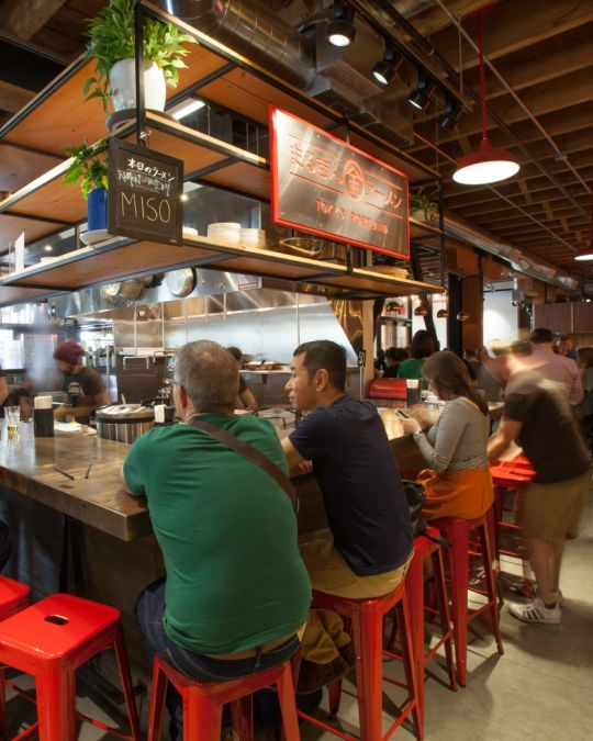 Diners enjoy authentic Japanese ramen at Marukin, inside Pine Street Market.