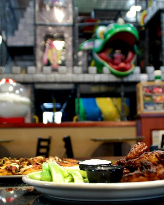 Parents can nosh on wings and other snacks as kids explore PlayDate PDX\'s three-story castle.