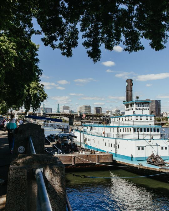 The Oregon Maritime Museum, housed in an historic steam-powered, sternwheel ship-assist tugboat, is permanently moored in the Willamette River by Tom McCall Waterfront Park.