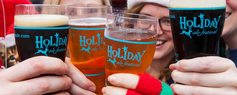 Give cheers for beers underneath the Holiday Ale Festival\'s clear tent.