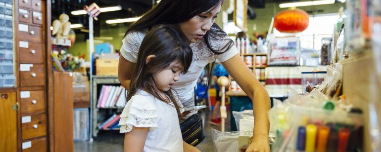 A family browses school supplies at Scrap.