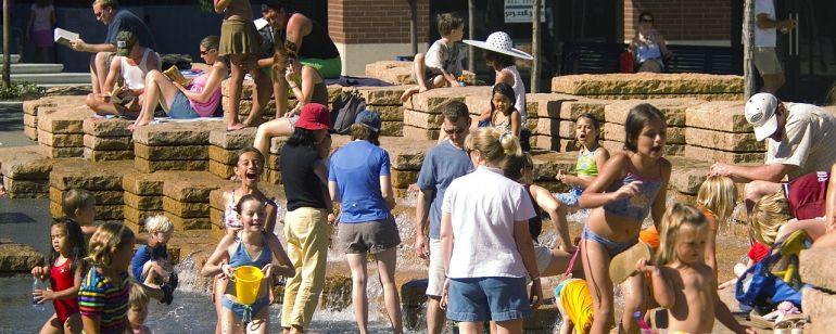 Kids play in the fountain at Jamison Square in the Pearl District.