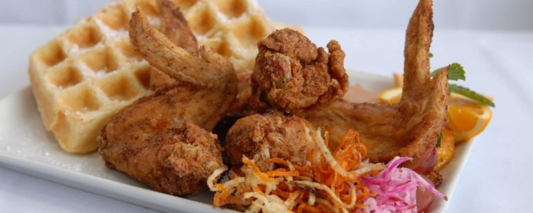 Dig into classic chicken and waffles at Po\'shines Café De La Soul.