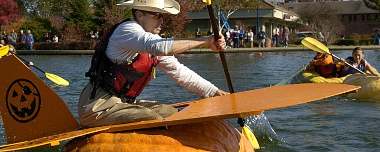 Paddlers navigate the lake at Tualatin Commons during the West Coast Giant Pumpkin Regatta.