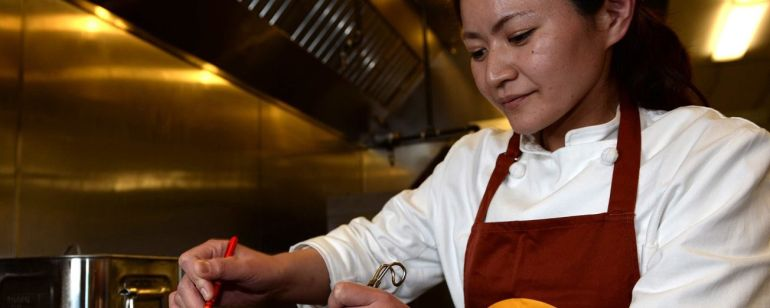 Chef Mayumi Hijikata prepares ramen at Marukin Ramen.