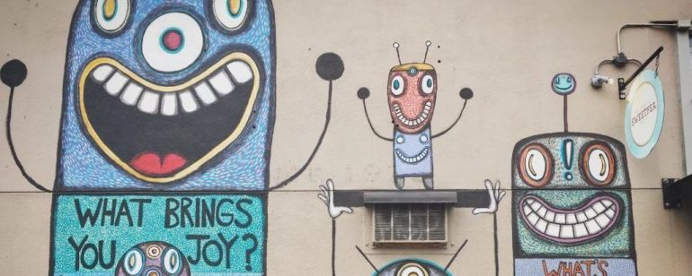 "Gary Hirsch has painted several \""BotJoy\"" murals around Portland."