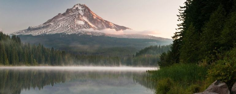 Enjoy a breathtaking sunrise over Mount Hood while camping at Trillium Lake.