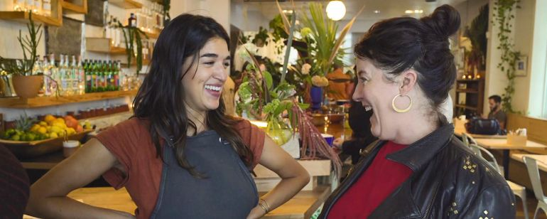 Chef Megan Sanchez greets Chef Naomi Pomeroy (Beast) at her restaurant, Güero, in Southeast Portland.