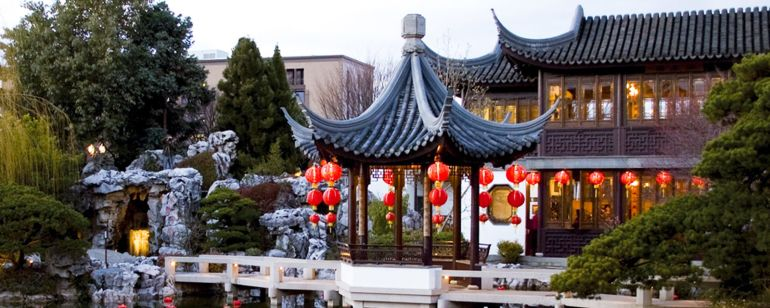 Lanterns floating in the serene water at Lan Su Chinese Garden in Old Town Chinatown.
