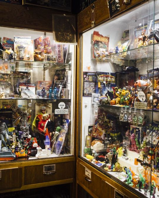 Vintage toys on display behind glass at Billy Galaxy