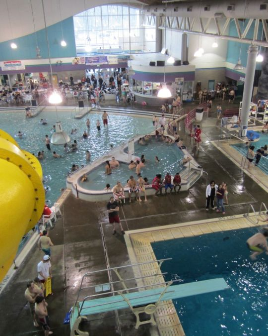 Swimmers beat the summer heat at the indoor North Clackamas Aquatics Center with slides and pools