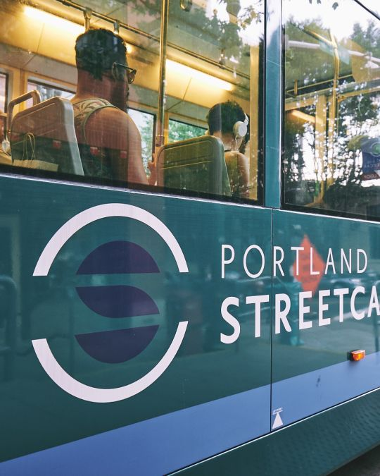 people traveling inside the Portland Streetcar