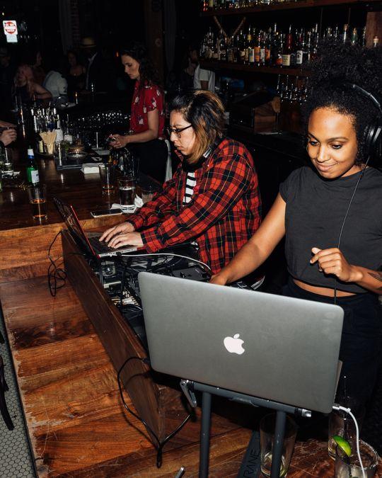 djs at a bar