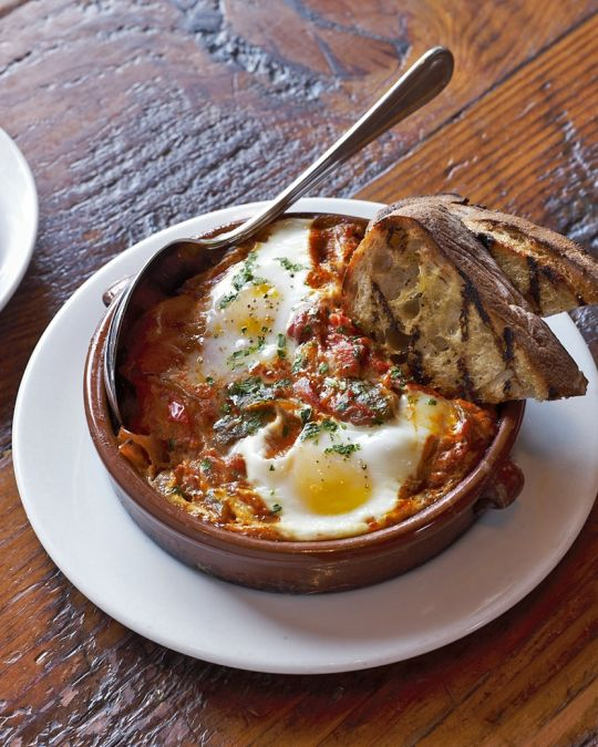 A savory breakfast dish with egg and toasted bread