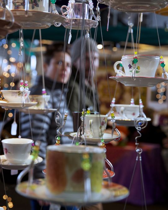 hanging teacups and saucers on display for sale