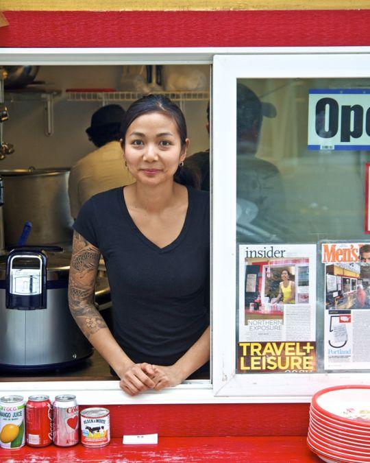 Nong Poonsukwattana, owner of Nong\'s Khao Man Gai, at cart service window.