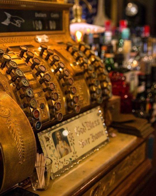 an old-time cash register on a bar