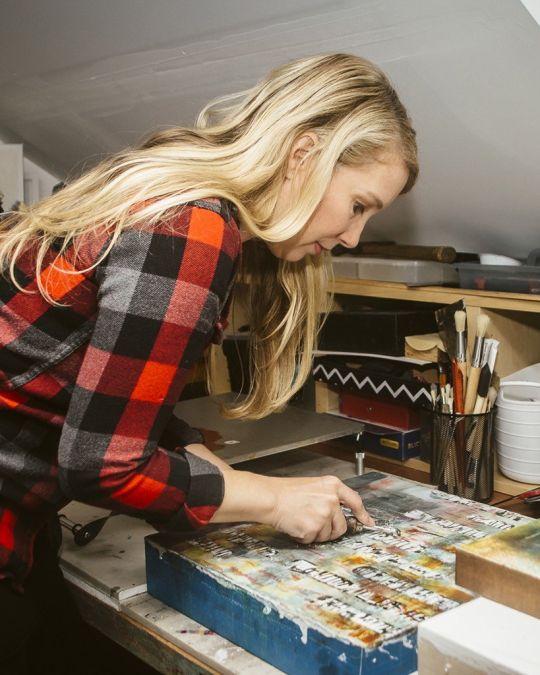 a woman creates art in a studio