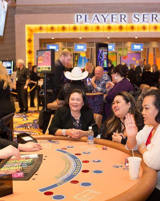 three women at a gaming table