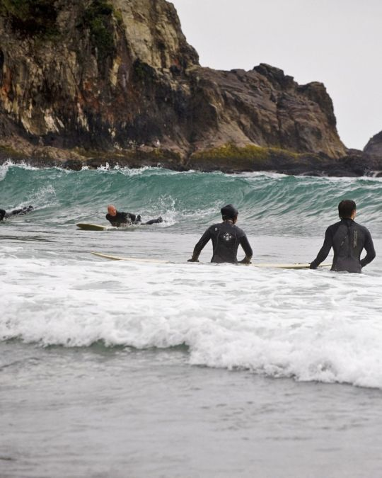 Surfers at Oswald West State Park on the Oregon Coast