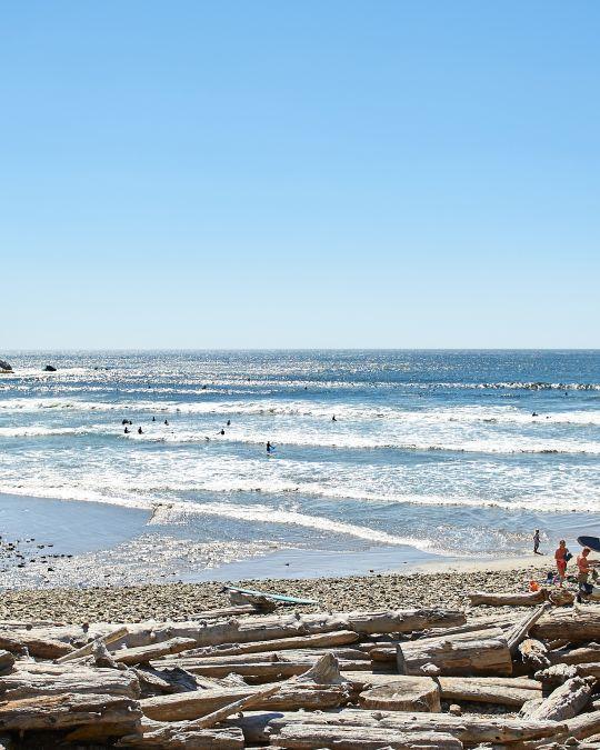 rugged coastline and a sandy beach on a sunny day