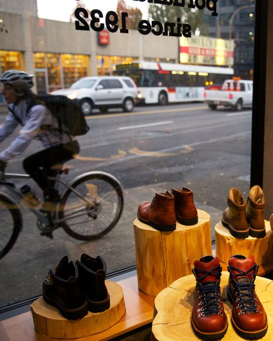 display of boots next to a storefront window