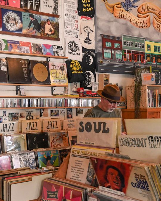 A man browses bins of records in a vintage record store
